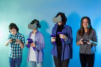 Group of kids using a gaming gadgets for virtual reality
