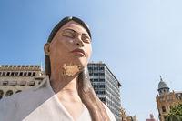 Large paper mache statue of meditating women on 'Placa de L' Ajuntament' for Fallas, Valencia, Spain