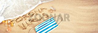 Corona virus written in the sand on vacation