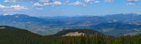 Carpathian mountain plateau spring panorama with fir forest on slope, Ukraine.