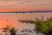 Sunset at Lake Constance, in the background the Hegau volcanos, Allensbach, Germany