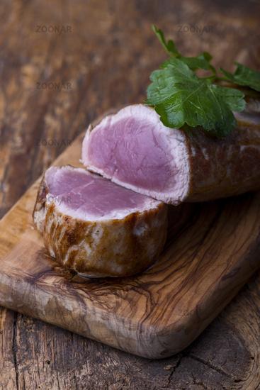 grilled pork tenderloin on dark wood