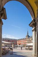 Plaza Mayor in Madrid through gate arch