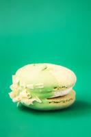 green Cake macaron or macaroon on green background.