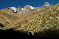 Moon setting above a trekker's camp in the upper Kong Togpo Valley in Ladakh