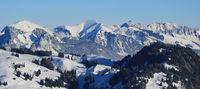 Winter landscape seen from Horneggli, Switzerland. Snow covered mountain ranges.