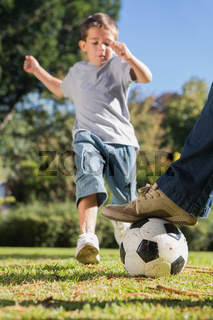 Boy kicking the football