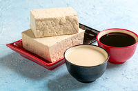 Soy curd (tofu), milk and sauce.