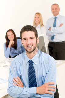 Business team handsome businessman with colleagues