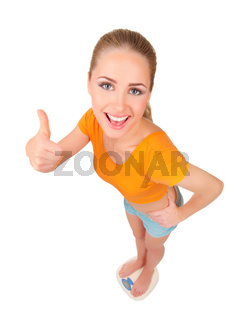 Young smiling woman on scales isolated