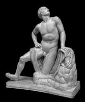 Ancient roman marble statue of a boy. Young man figure statue isolated on black background. Antique sculpture
