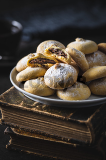 Cookies with chocolate cream. Sweet biscuits on plate.