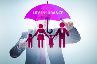 Life insurance concept with businessman pressing button