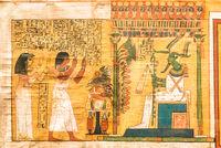 Ancient Egyptian papyrus with hieroglyphic. Antique manuscript.