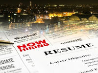 Closeup of Resume on Newspaper