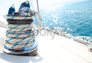 Sailboat winch and rope yacht detail