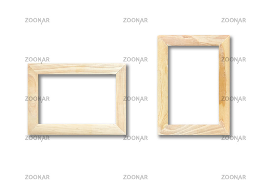 Two wooden picture frames hanging on a white wall