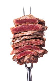 Scheiben Steak auf eine Fleisch-Gabel