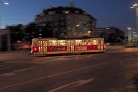 Moving red tram trough night city, Prague, Czech republic