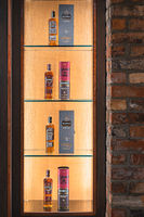 Selection of aged 16 and 21 years Bushmills whiskey with a boxes on illuminated display in distillery shop
