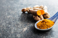 Indian turmeric powder and root. Turmeric spice. Ground turmeric