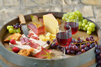 South Tyrolean specialties served on a wine barrel