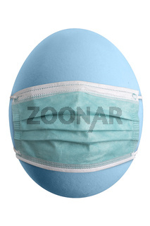 Large picture of an isolated easter egg with a corona mask.