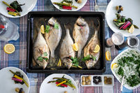 Preparing delicious fish with vegetables