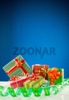 Christmas presents against blue background