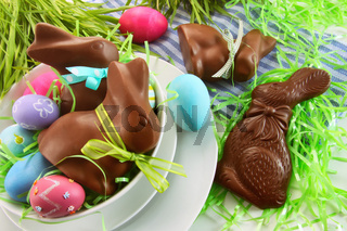 Assorted easter bunnies and eggs on kitchen counter