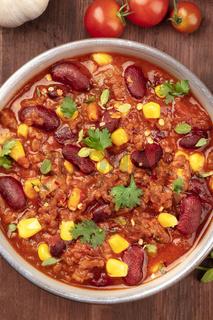 Chili con carne, traditional Mexican dish, closeup photo