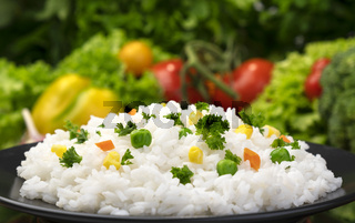 Cooked rice porridge, served with herbs and vegetables