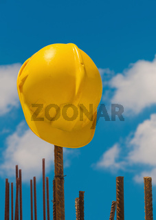 Construction helmet on steel bars