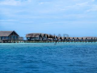 Row of villas on stilts