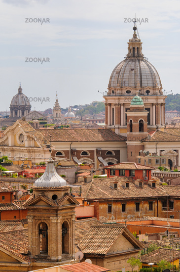 Panoramic view to Rome rooftops with catholic basilics and monuments, Italy