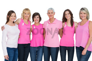 Happy women wearing pink for breast cancer awareness