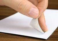 Stamp being pasted onto an envelope