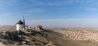 A view of the windmills and castle of Consuegra in La Mancha in central Spain