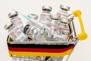 Vials with the Moderna and Pfizer-Biontech Covid-19 vaccine are laying in a german shopping trolley as symbol