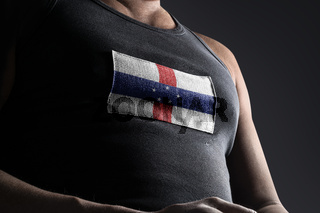 The national flag of Netherlands Antilles on the athlete's chest