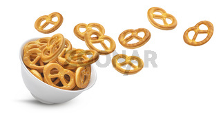 Falling salted pretzels isolated on white background