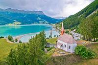 Curon Venosta at Graun im Vinschgau on Lake Reschen submerged tower and Alpine landscape aerial view