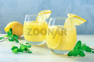 Lemonade. Homemade fresh citrus beverage with lemon and mint, with ice