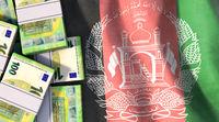Bundles of euro banknotes lie on Afghanistan flag