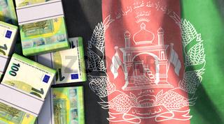 Euroschein-Geldbündel liegen auf Afghanistan-Flagge