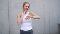 Sportswoman checking pulse during training