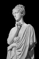 Gypsum copy of ancient statue of thinking young lady isolated on black background. Side view of plaster sculpture woman face