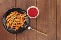 Sweet potato fries with rosemary and ketchup, shot from above