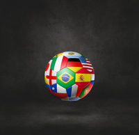 Football soccer ball with national flags on a black studio background