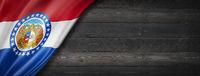 Missouri flag on black wood wall banner, USA